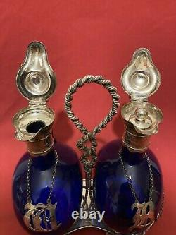 Antique Double Bristol Blue Decanters in a Silver Plated Rope Twist Tantulus